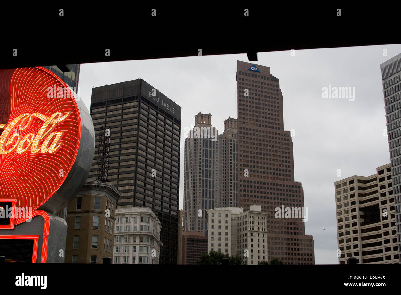 downtown Atlanta buildings skyscrapers equitable GP Cola business offices office Overcast building sign city urban - Stock Image