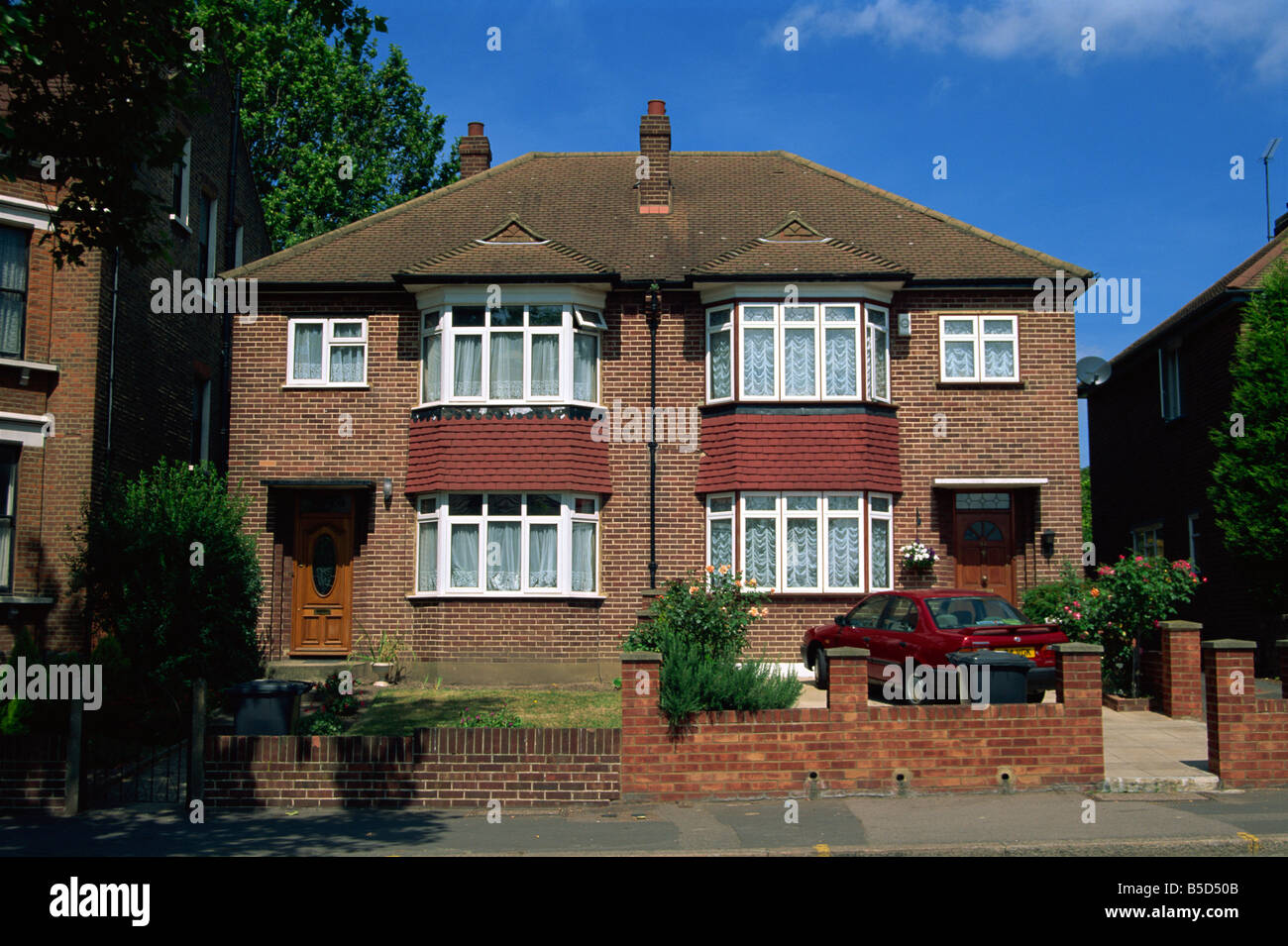 A pair of semi detached houses from the inter war years in Herne Hill London SE24 N Boyd - Stock Image