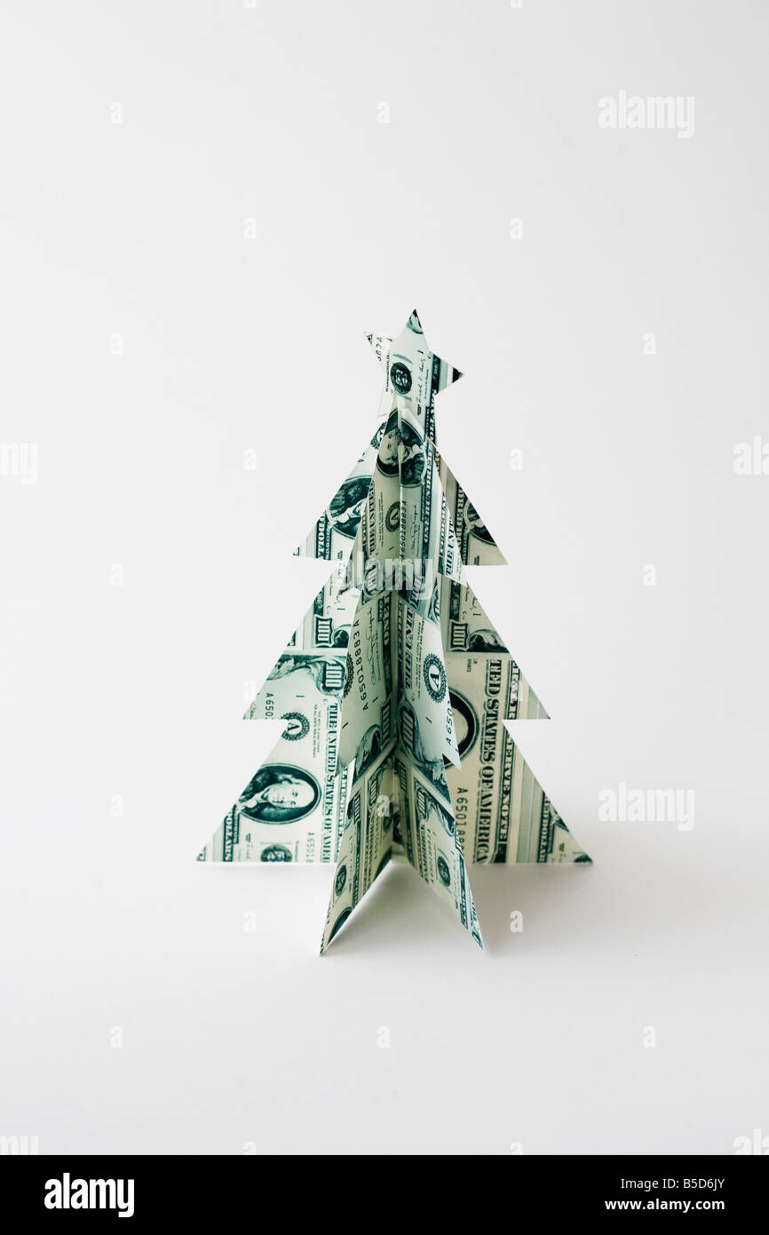 Christmas tree made of money holiday spending cost save money - Stock Image