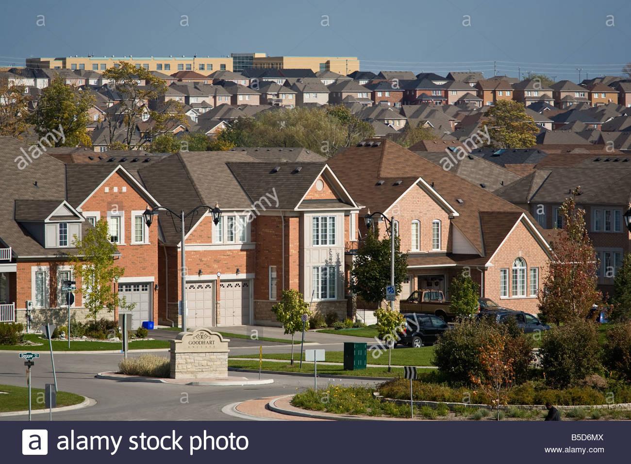 New housing creates suburban sprawl on former farmland in town of Ajax near Toronto in Southern Ontario Canada - Stock Image