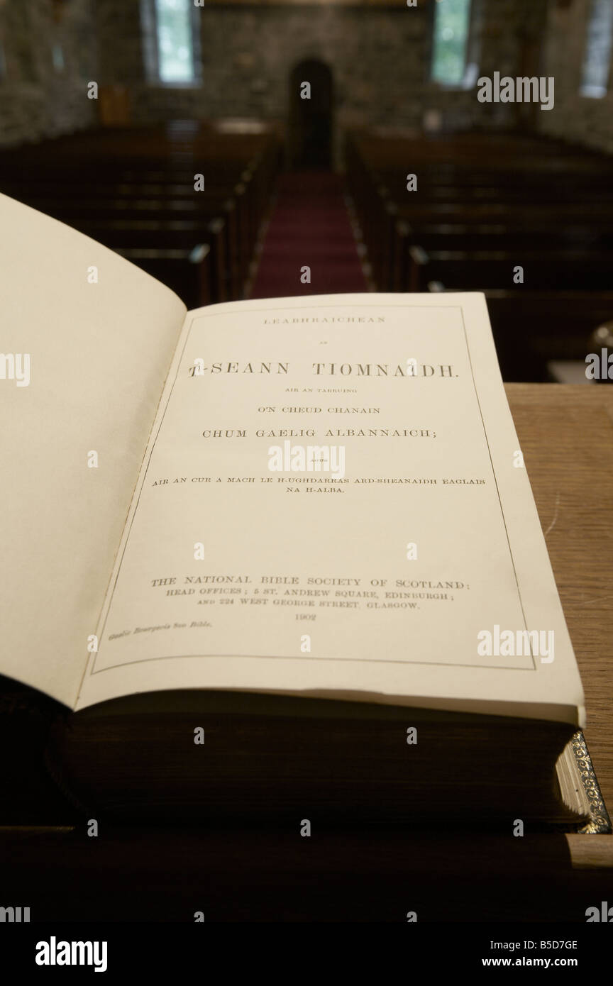 vicars view from the pulpit apse of a church looking over the holy bible in gaelic down the aisle across the pews Stock Photo
