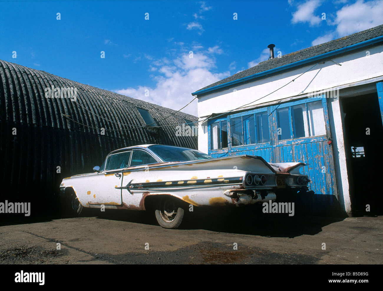 American old  Car outside building 60's sixties 50s fifties - Stock Image
