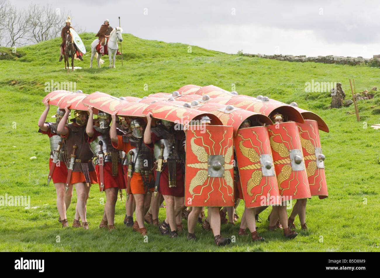 Ermine Street Guard advancing with protective shields, cavalry, Birdoswald Roman Fort, Hadrians Wall, Northumbria, - Stock Image
