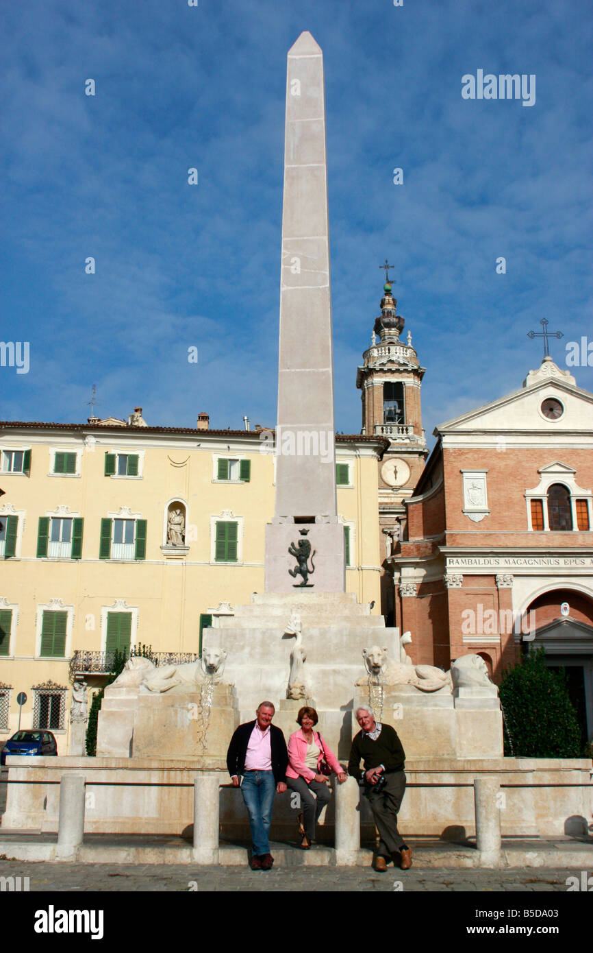 visitors at the Lion obelisk fountain in the 14th century historic beautiful walled  hilltown of Jesi in Le Marche,italy Stock Photo