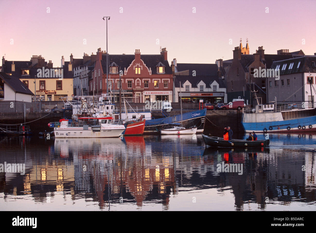 Stornoway (Steornabhagh) harbour at dusk, Isle of Lewis, Outer Hebrides, Scotland, Europe - Stock Image