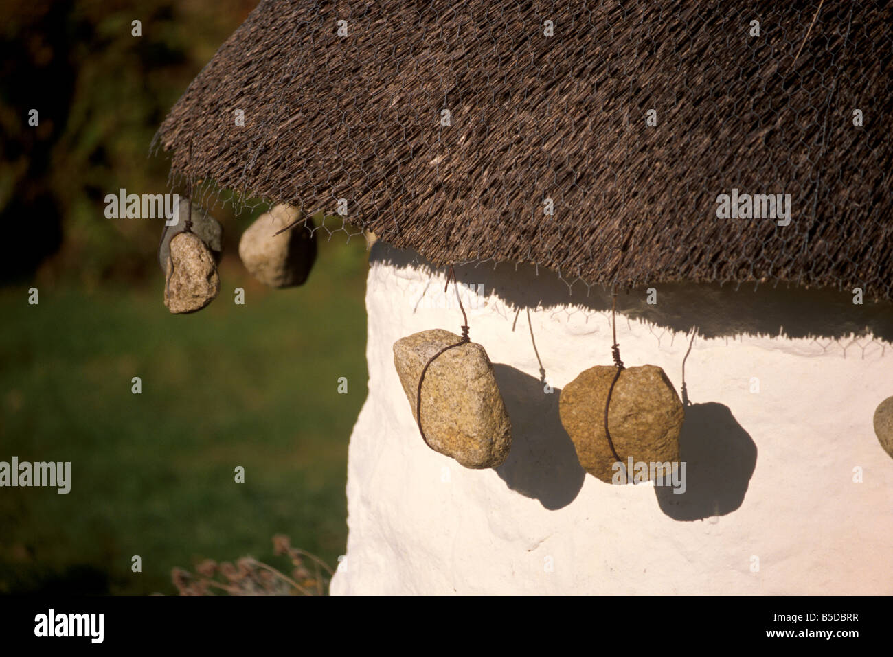 Thatched house with tied stones, Luib, Isle of Skye, Inner Hebrides, Scotland, Europe - Stock Image