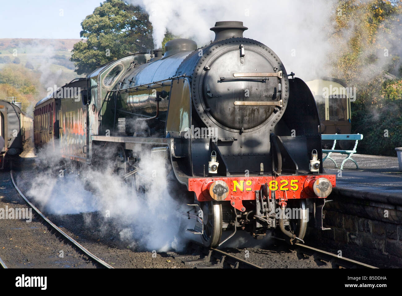 Grosmont station platform - 1930s Class S15 Maunsell 4-6-0 freight train locomotive design Ex SR 825 (BR 30825). - Stock Image