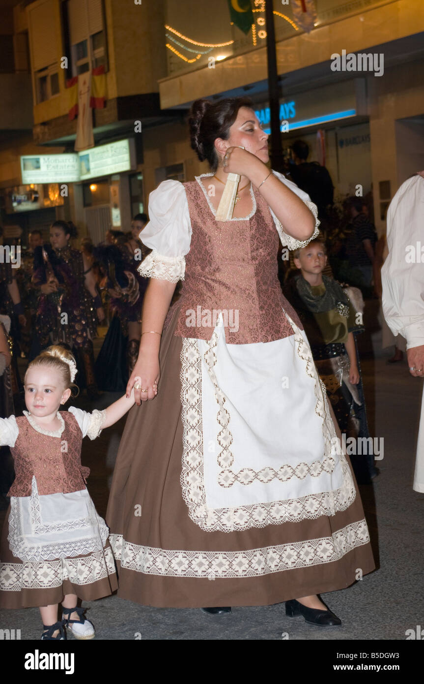 Female and Child in Traditional Costume at the Fiesta of Moors and Christians Guardamar Del Segura Spain Spanish - Stock Image