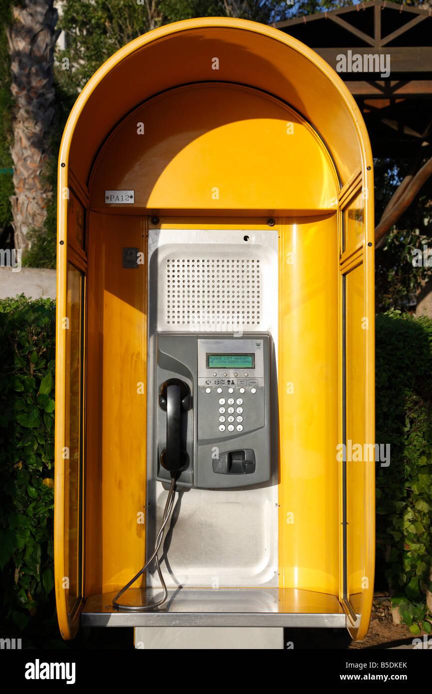 modern yellow public telephone booth protaras cyprus mediterranean - Stock Image