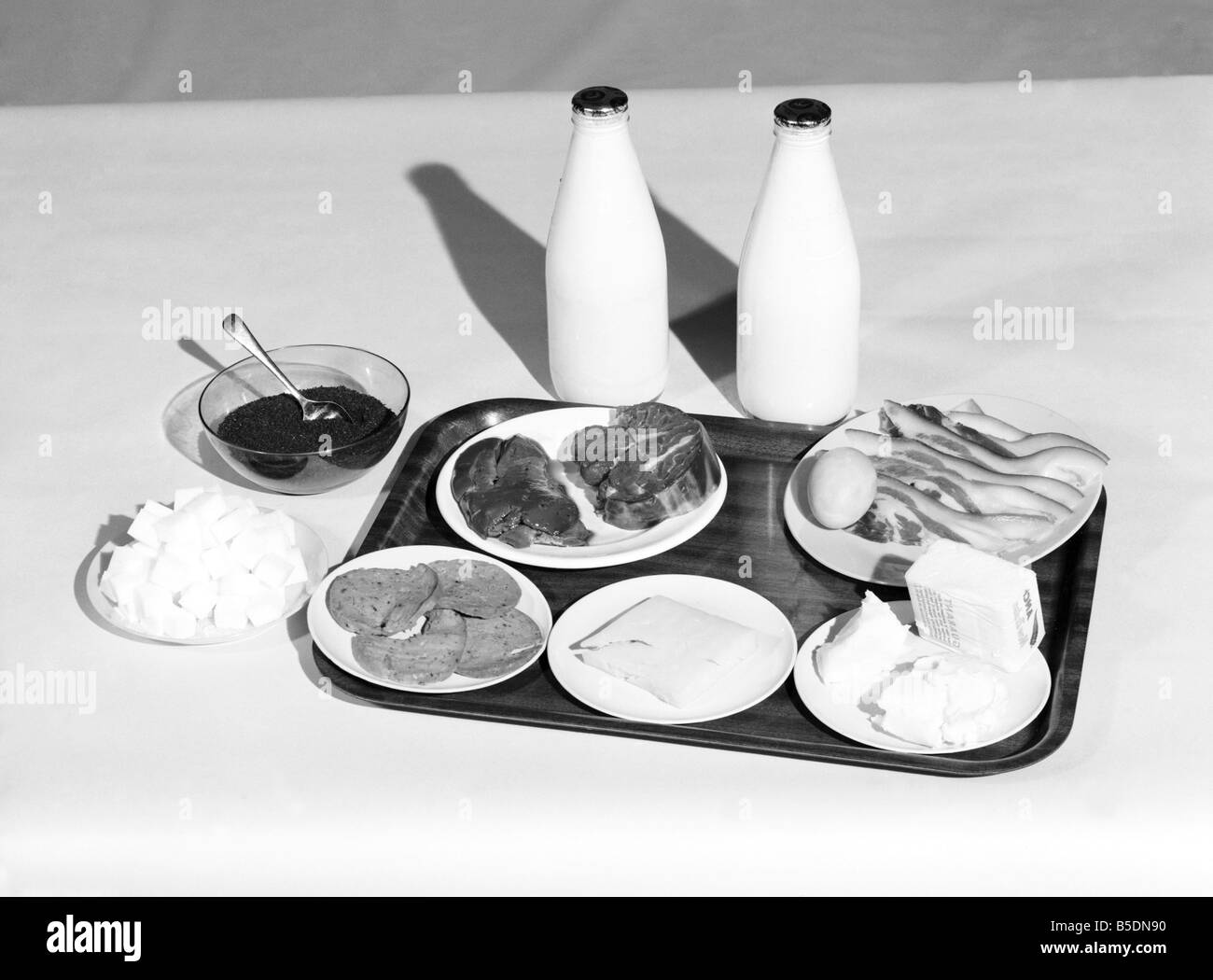 War Rations: This picture shows the amount of milk, butter eggs, sugar and meat that each adult was allowed a week - Stock Image