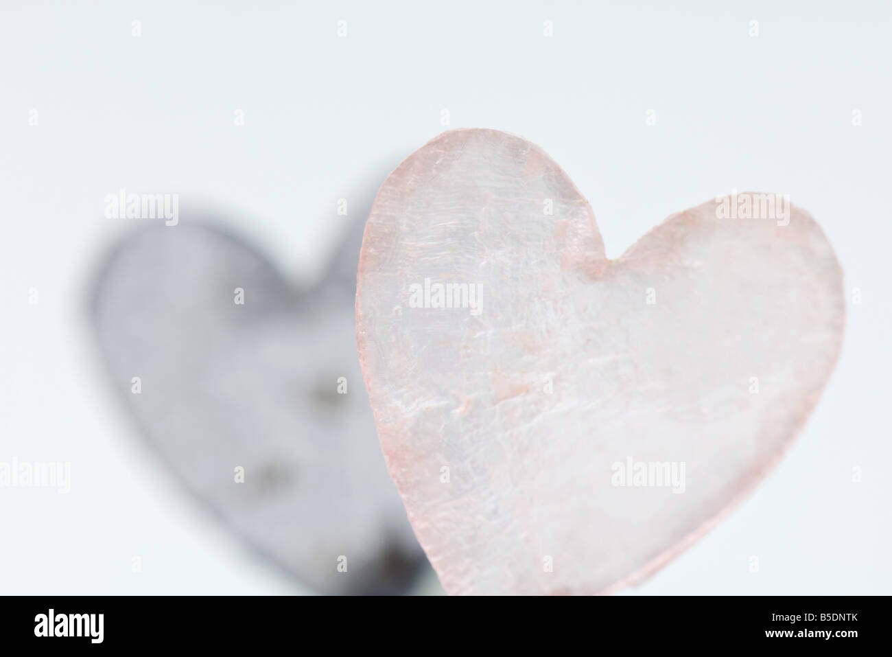 Heart-shaped piece of glass - Stock Image