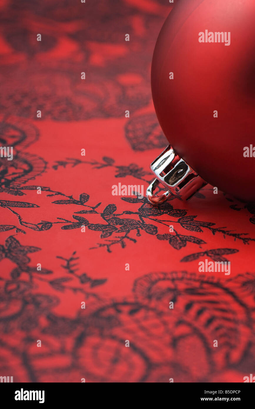 Red Christmas tree ornament, detail - Stock Image