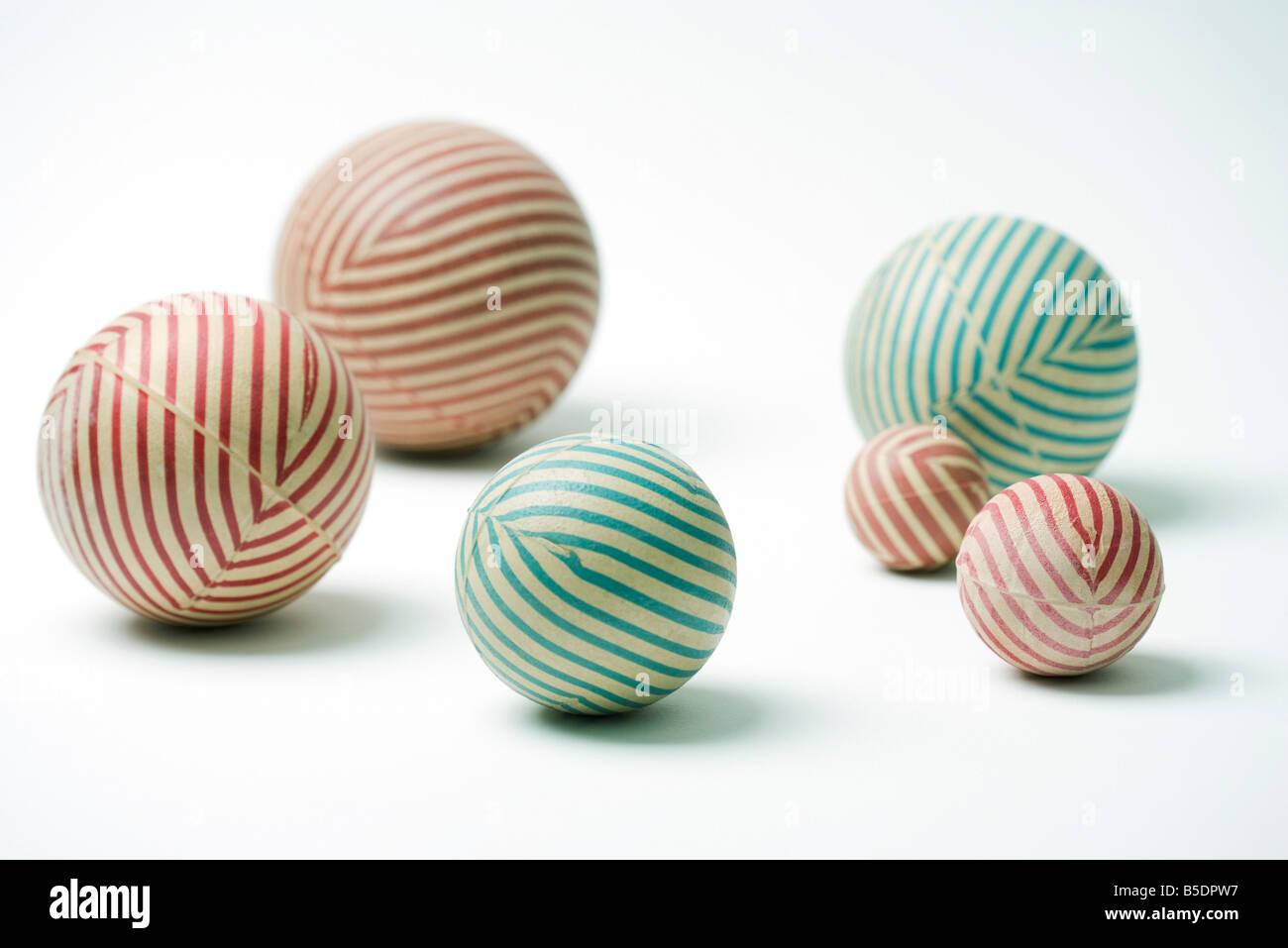 Striped rubber balls, still life - Stock Image