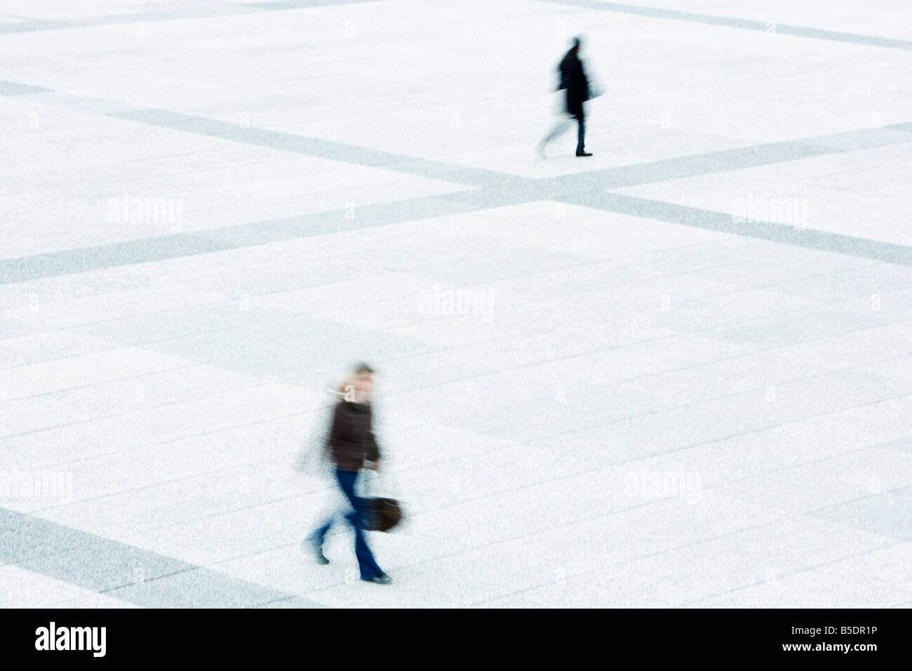 Pedestrians crossing public square - Stock Image