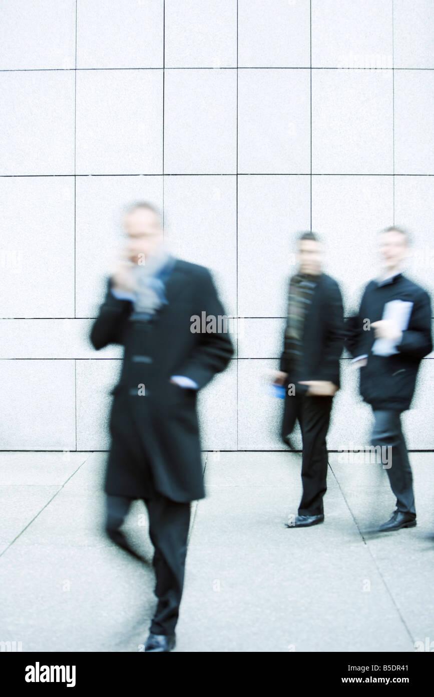 Pedestrians on sidewalk - Stock Image