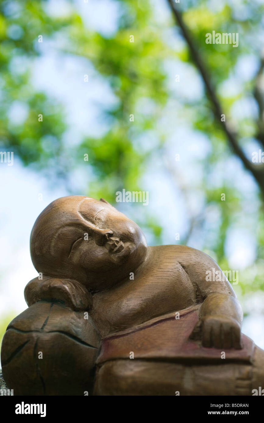 Sleeping Buddha statue, close-up - Stock Image