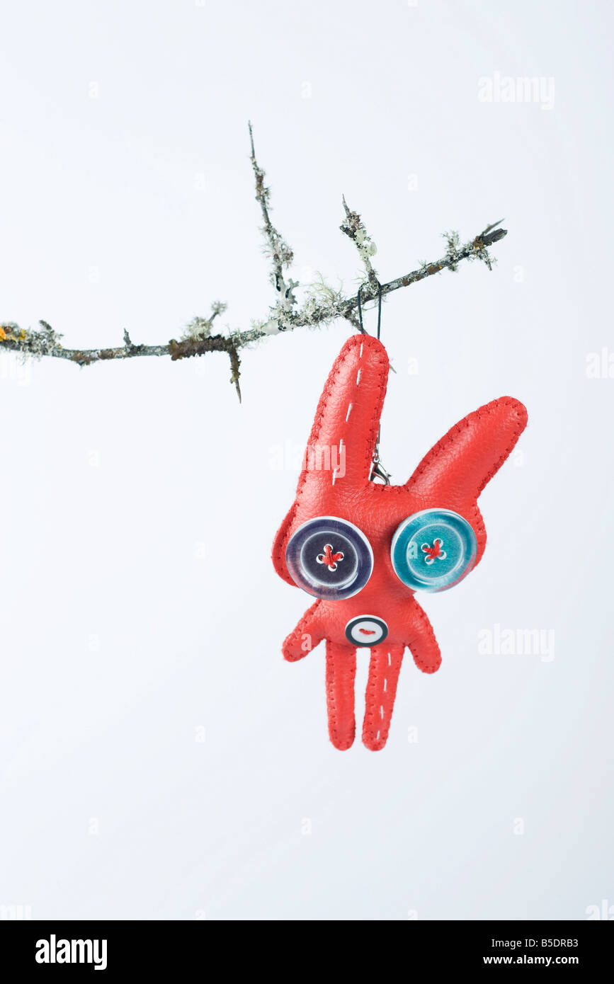 Rabbit ornament hanging from branch - Stock Image