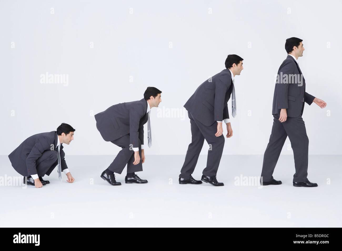 Businessman evolving, digital composite - Stock Image