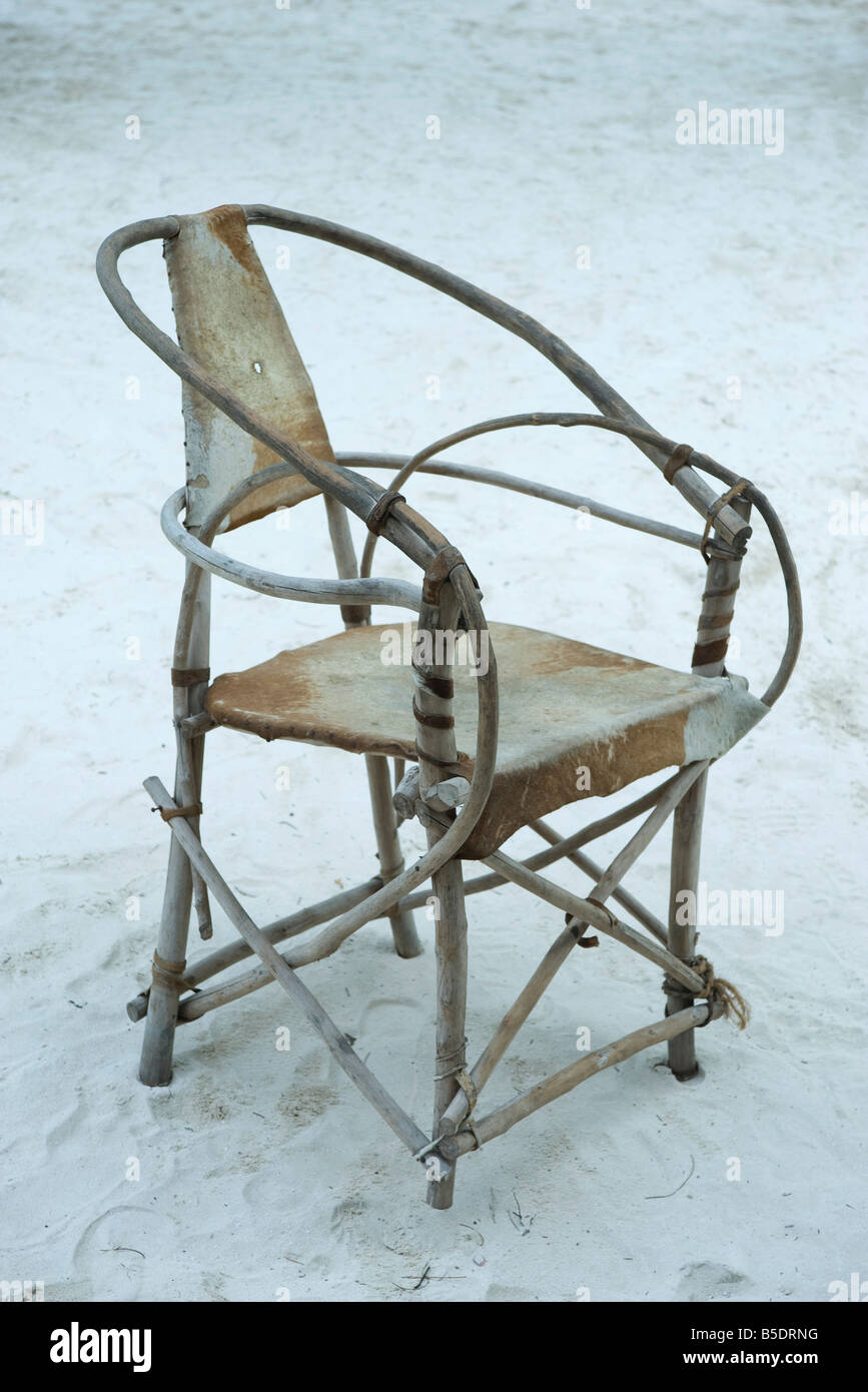 Hand-crafted chair on sand, Zanzibar, Tanzania - Stock Image