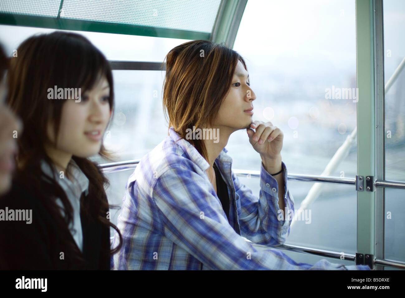 Friends taking ride on Ferris wheel at Tempozan Harbour Village, Osaka, Japan Stock Photo