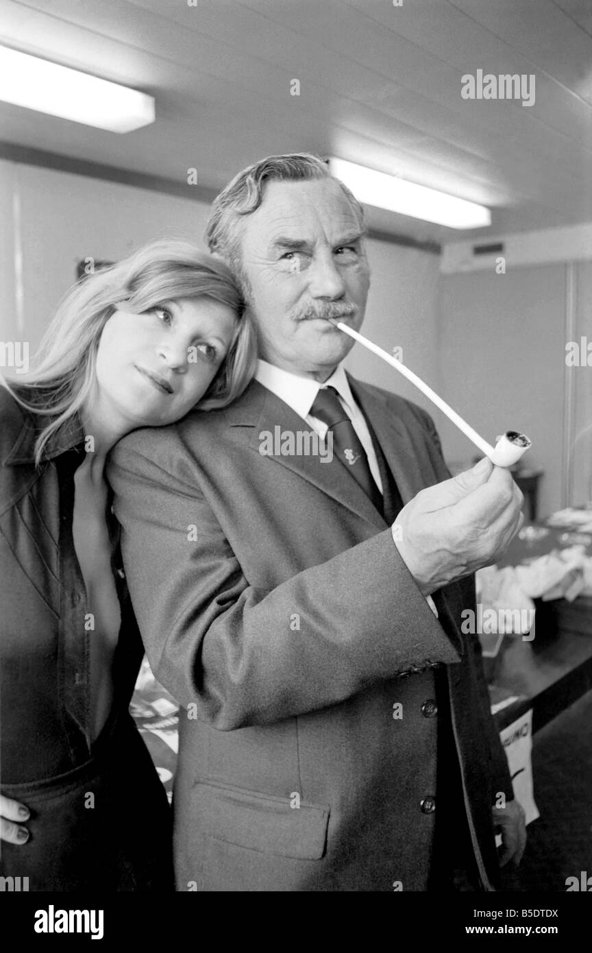 Pipe smoking Champion Robert Locke of Hayes, Middlesex, is pursued by typist Liliana Perez, like the TV advertisement - Stock Image