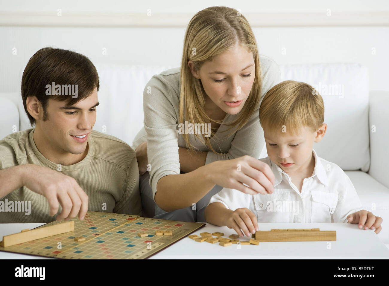 Family playing board game together - Stock Image