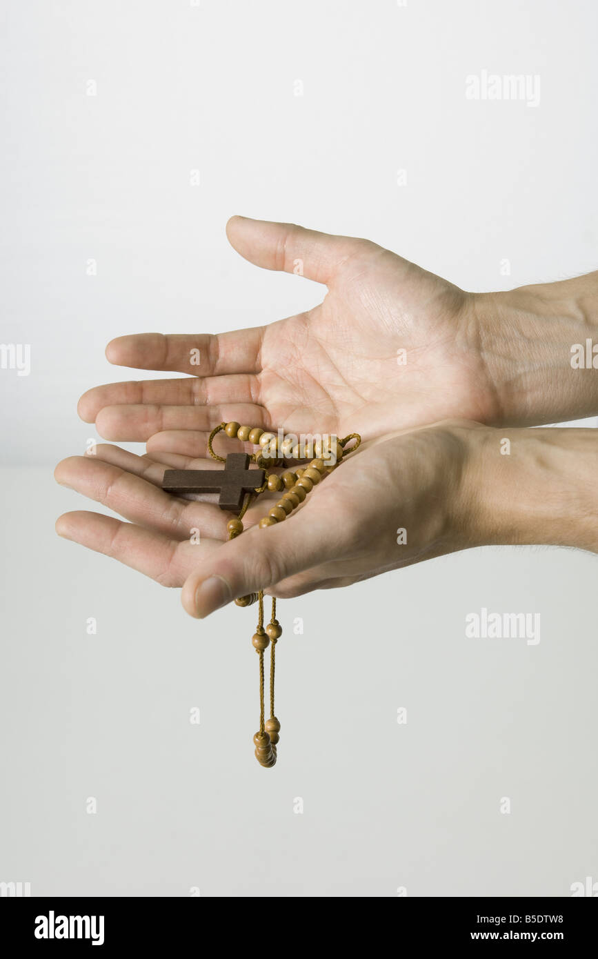Hands holding rosary - Stock Image
