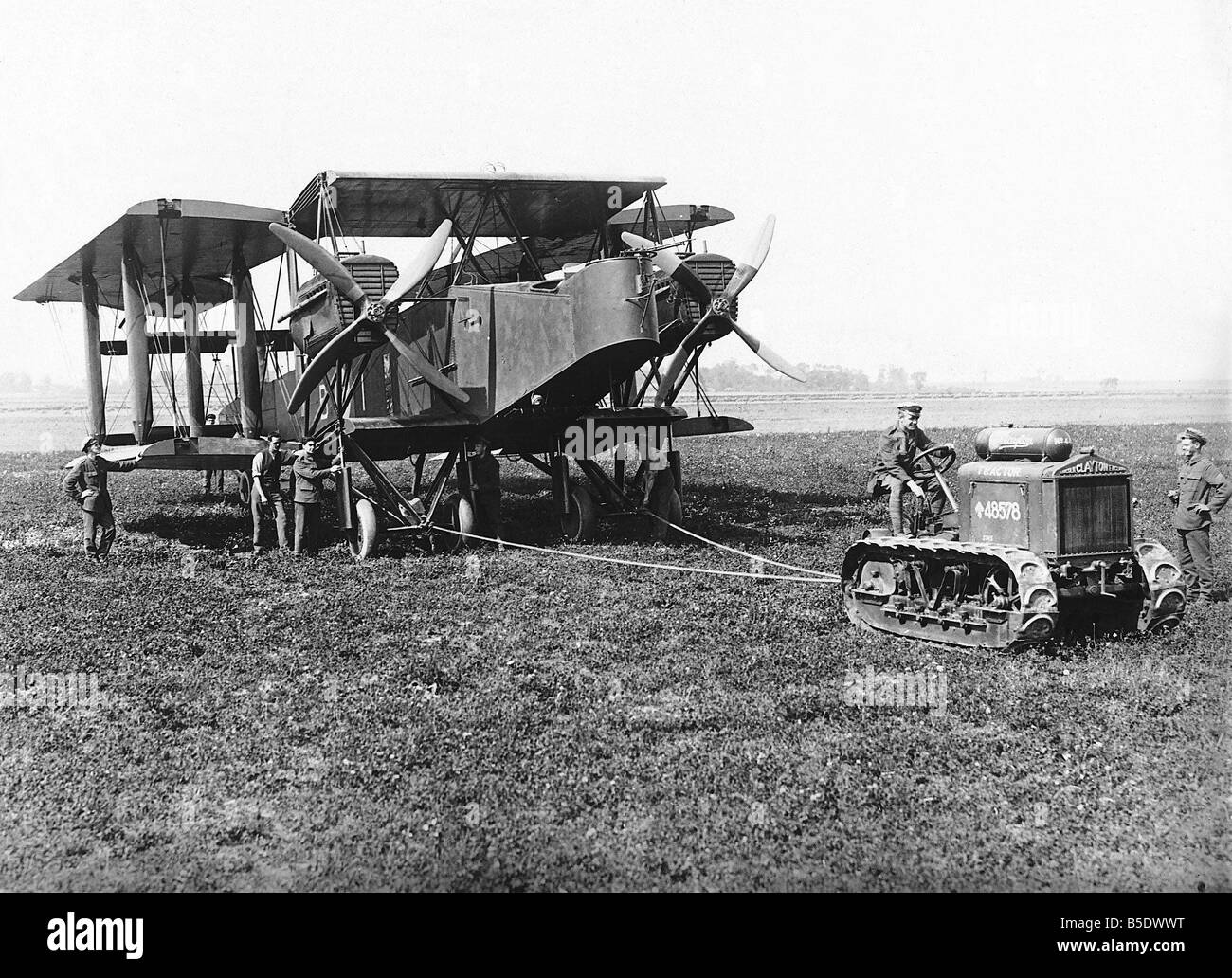 An RAF Vickers Vimy bomber with its wings folded back is pulled across a French aerodrome during World War One 1918 - Stock Image