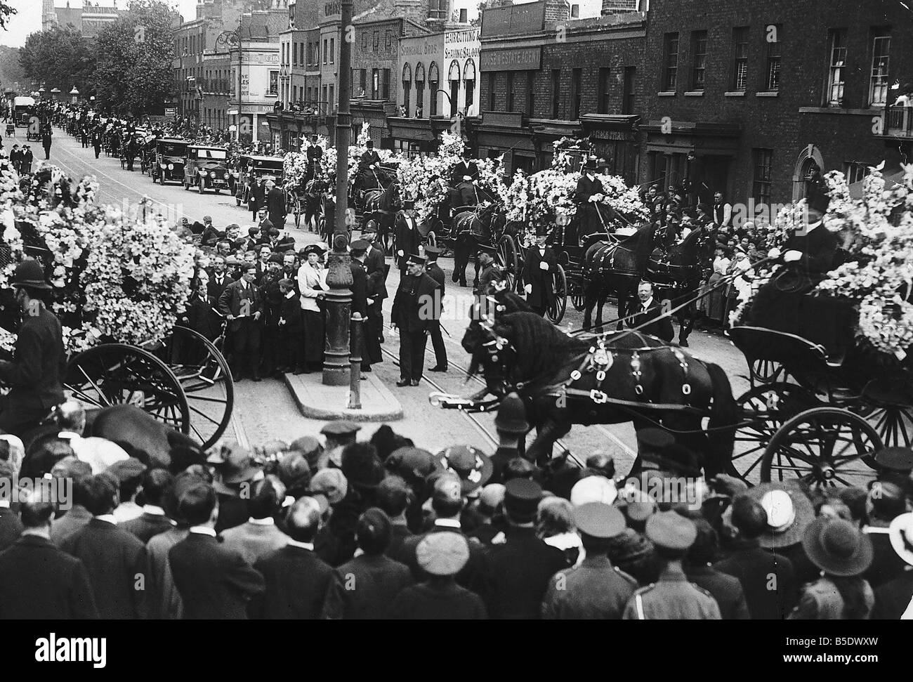 World War One A procession of horse drawn hearses carrying school children killed during an air raid over London - Stock Image