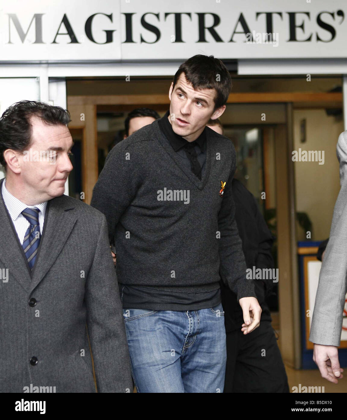 Newcastle United footballer Joey Barton leaves Liverpool Magistrates Court after appearing on on assault charges - Stock Image