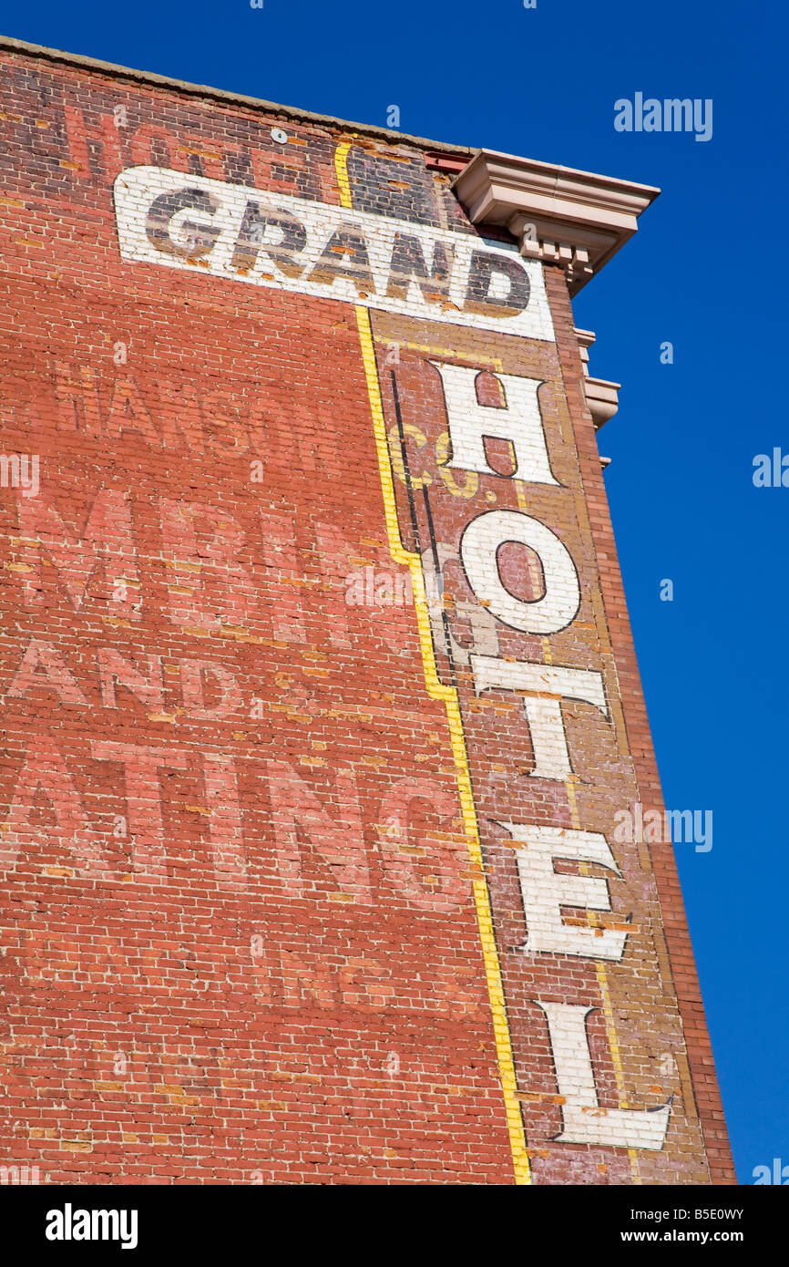 Faded murals on the Grand Hotel, National Historic District, Butte, Montana, USA, North America - Stock Image