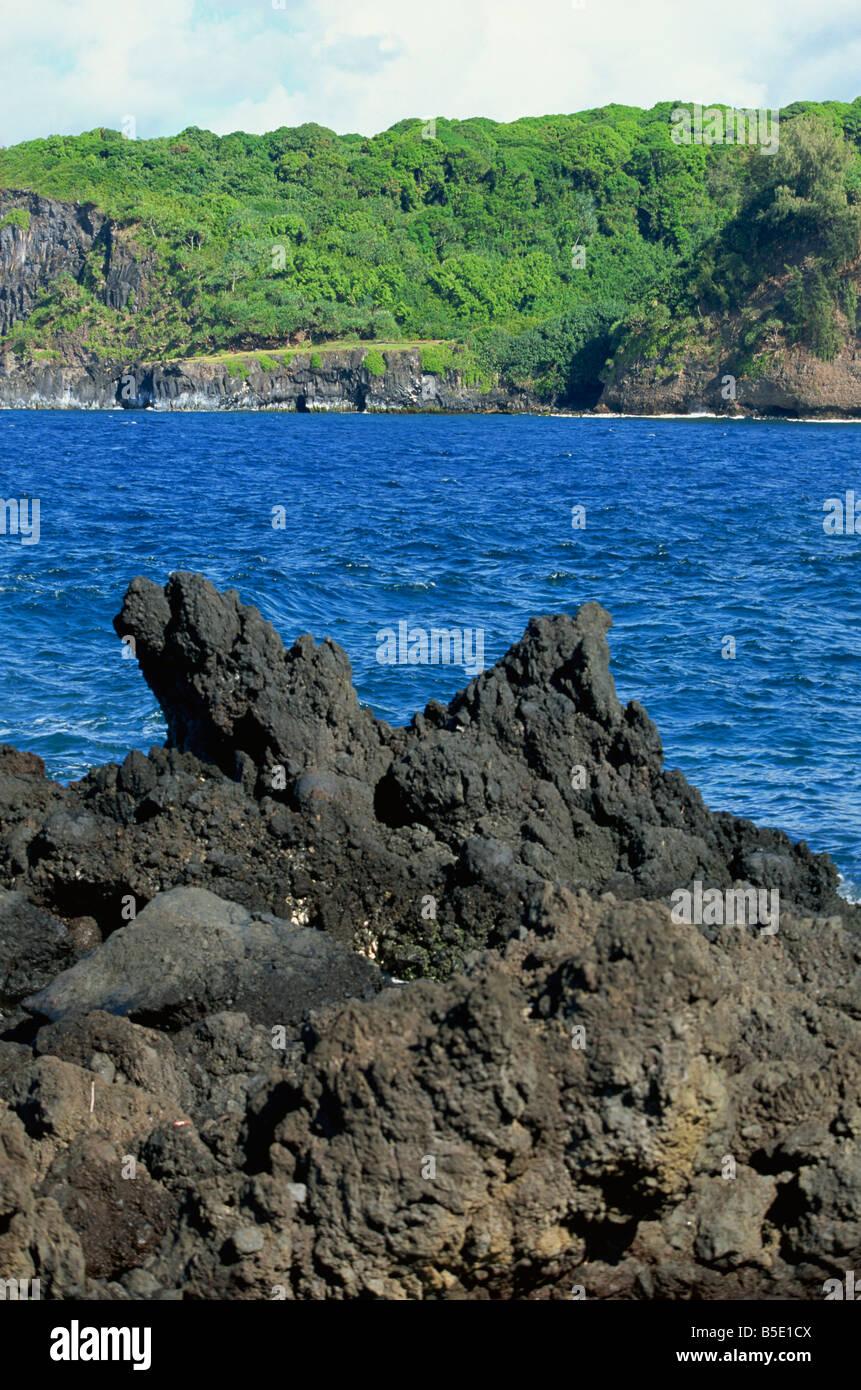 Jagged black lava shore on Keanae Peninsula, Hana Coast road, Maui, Hawaii, Hawaiian Islands, USA, Pacific, North - Stock Image