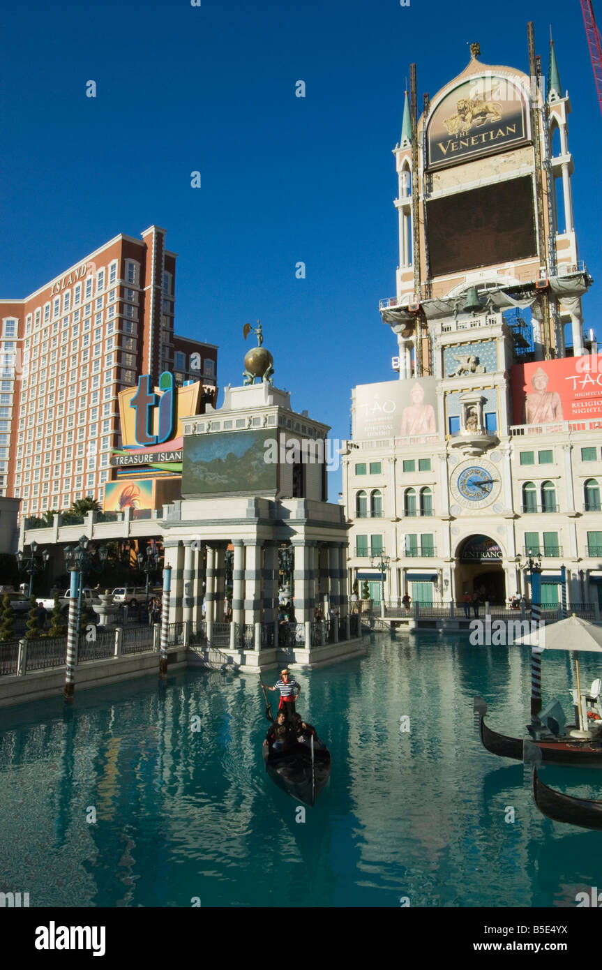 The Venetian Hotel, with gondoliers, on The Strip (Las Vegas Boulevard), Las Vegas, Nevada, USA, North America - Stock Image