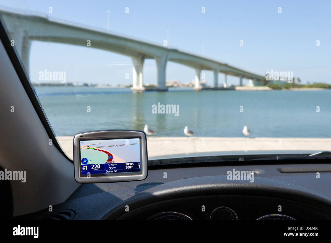 GPS Satellite Navigation System on the windscreen of a car in Clearwater, Florida, USA - Stock Image