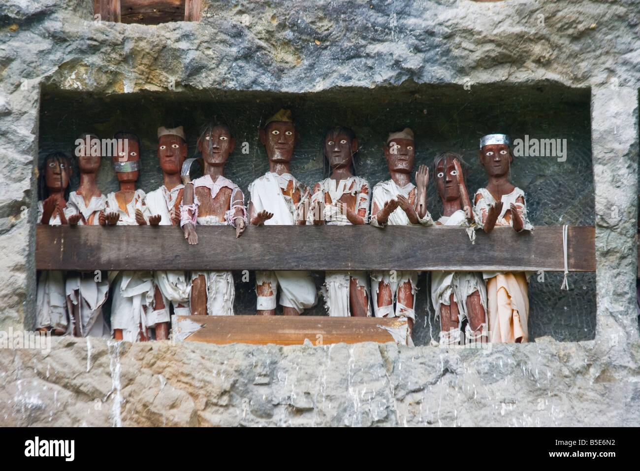 Funerary Tau Tau Effigies and Cave Cemetery in Lemo in Tana Toraja on Sulawesi in Indonesia - Stock Image