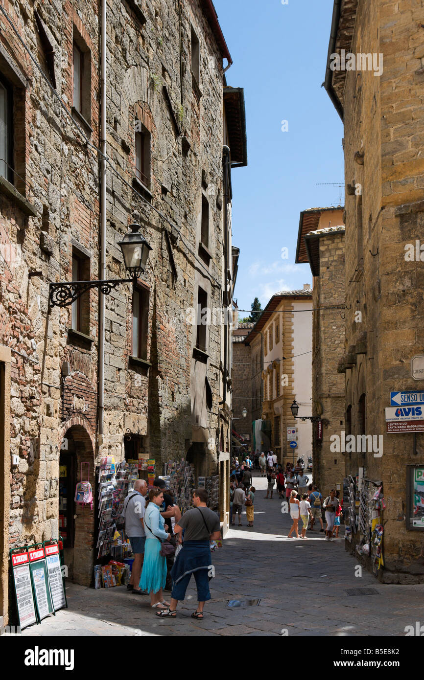 Typical street and shops in the hill town of Volterra, Tuscany, Italy - Stock Image