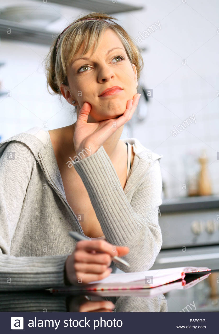 young woman thinking about some problems Stock Photo