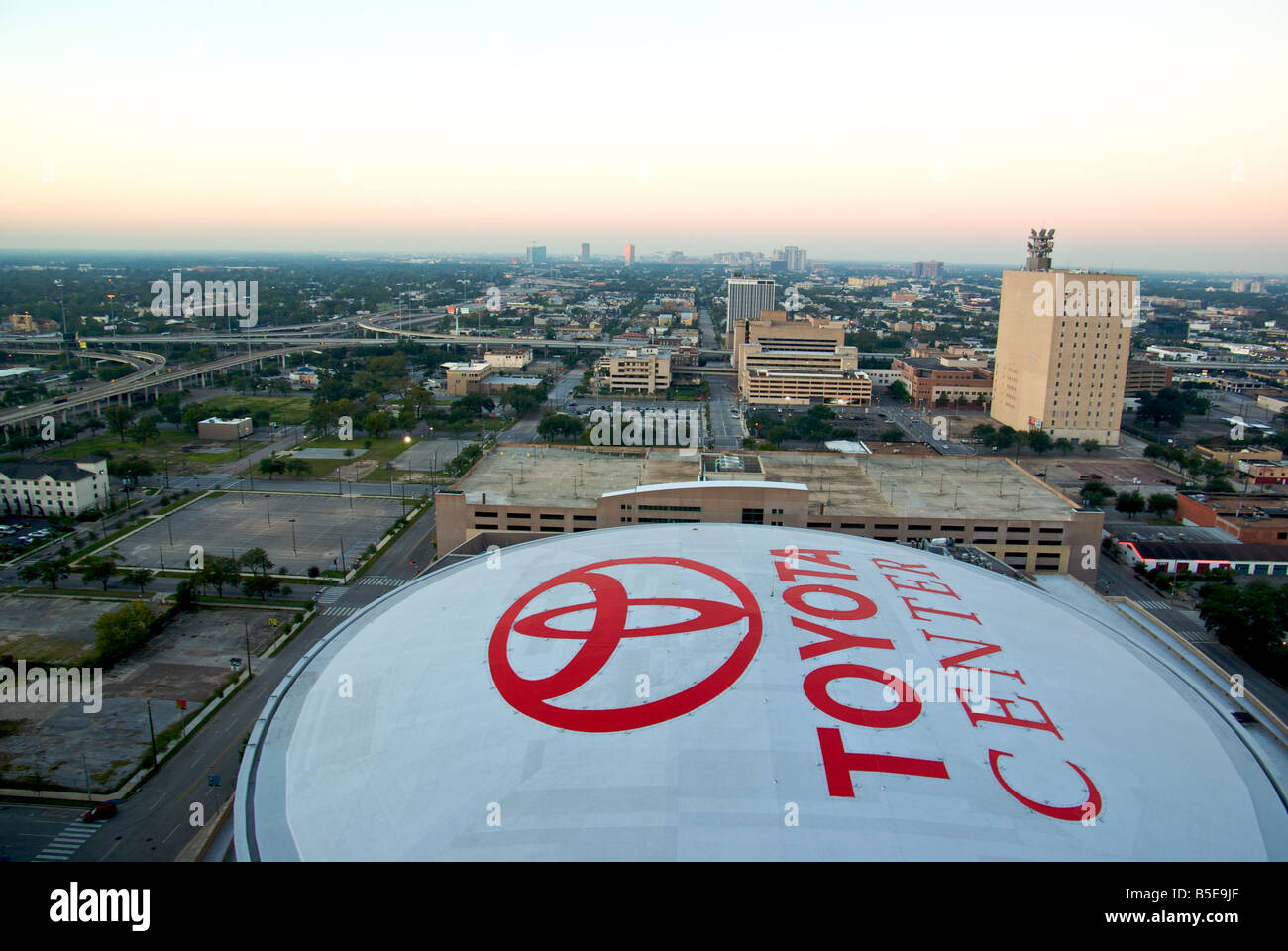 The Roof Of The Toyota Center Basketball And Ice Arena At Dawn Looking West  Over Downtown