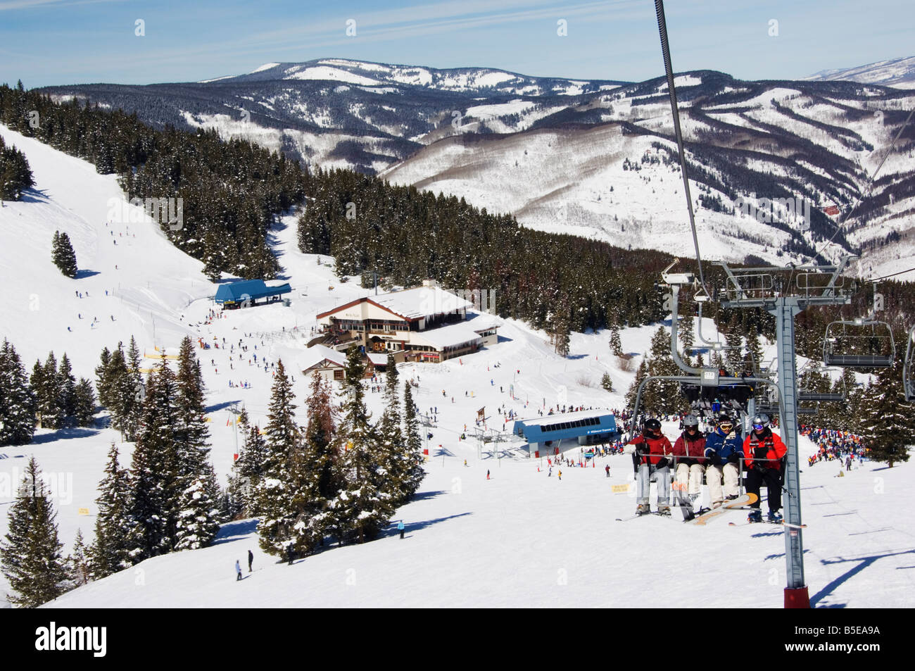 Skiers being carried on a chair lift to the back bowls of Vail ski resort, Vail, Colorado, USA, North America - Stock Image