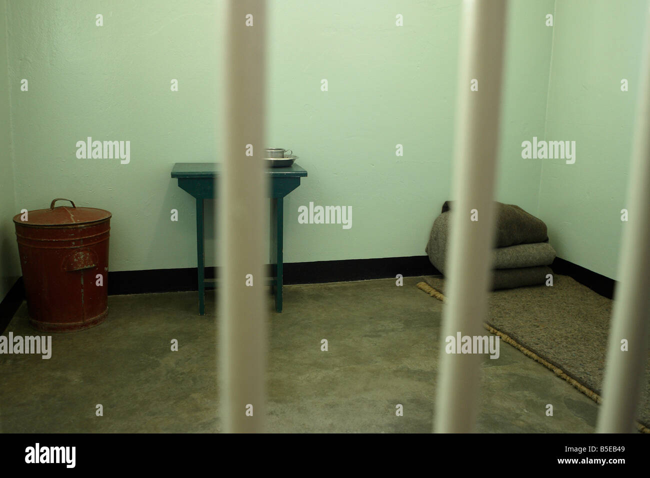 The Prison Cell of Nelson Mandela during his sentence at Robben Island Maximum Security Prison , Cape Town , South - Stock Image