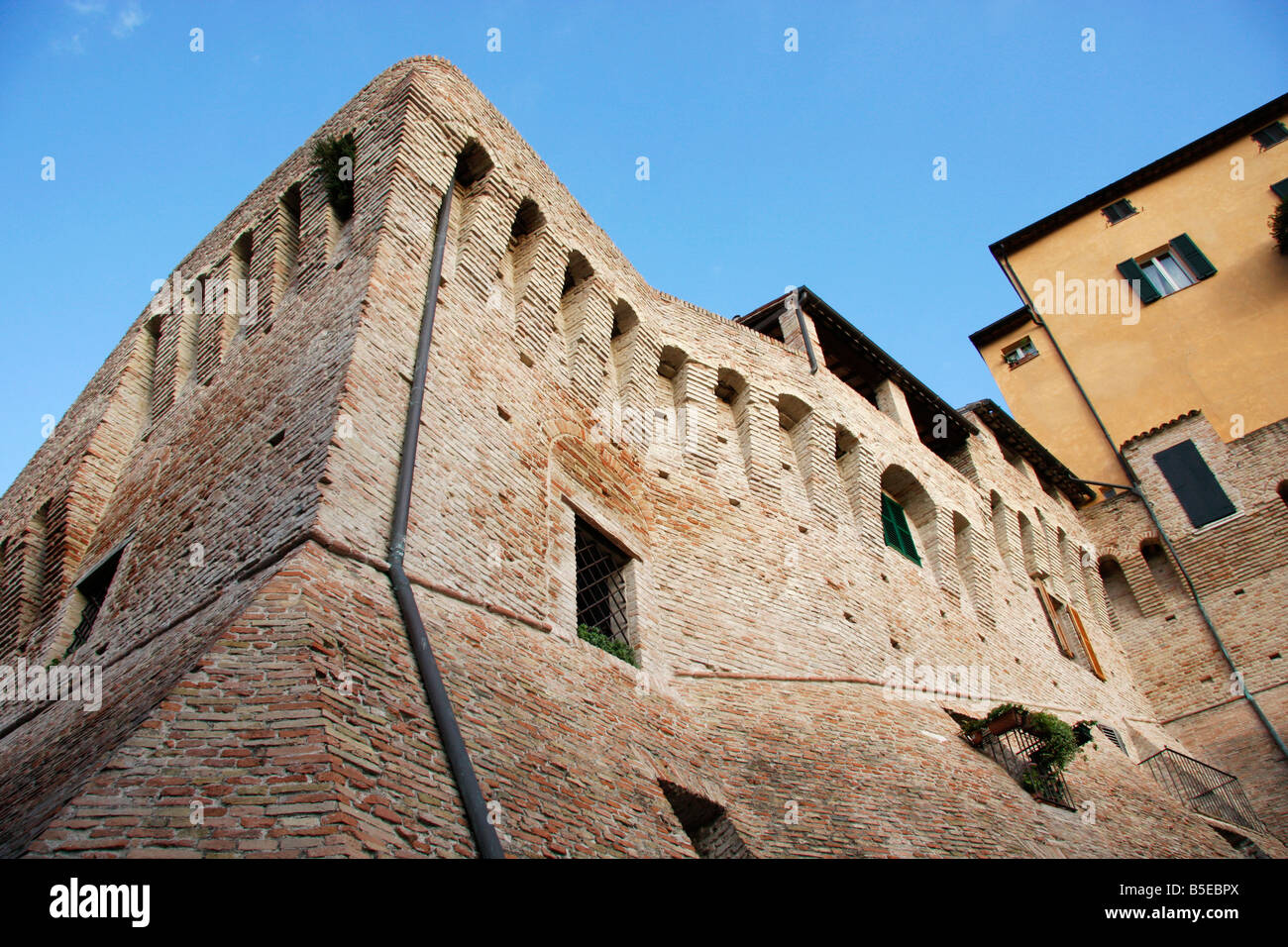 colorful house built on top of the historic walls of the beautiful hilltown of Jesi in Le Marche, Italy Stock Photo