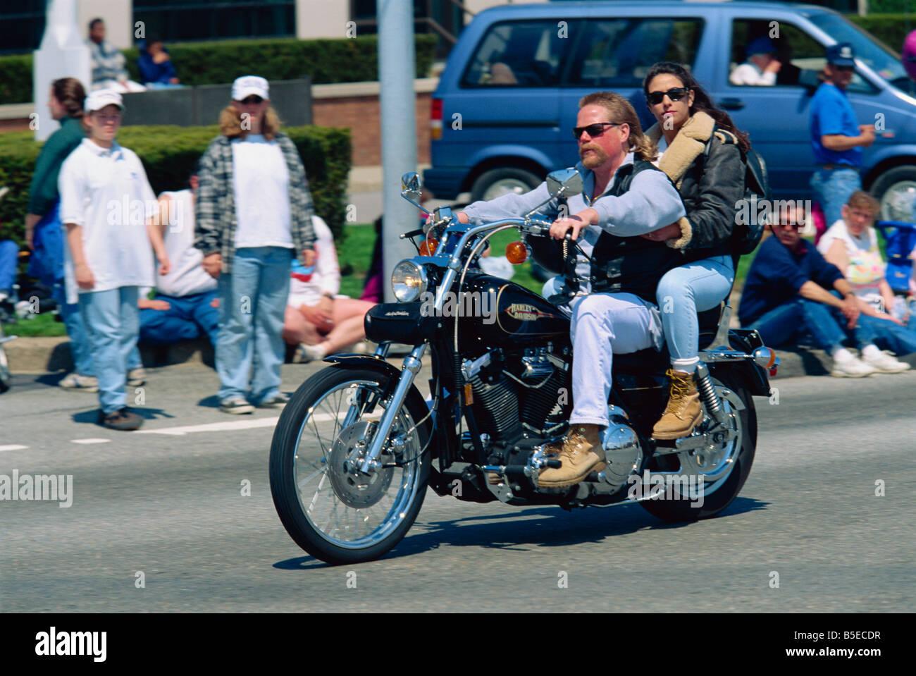 Couple on a Harley Davidson motorbike in Newport, Rhode Island, USA, North America - Stock Image