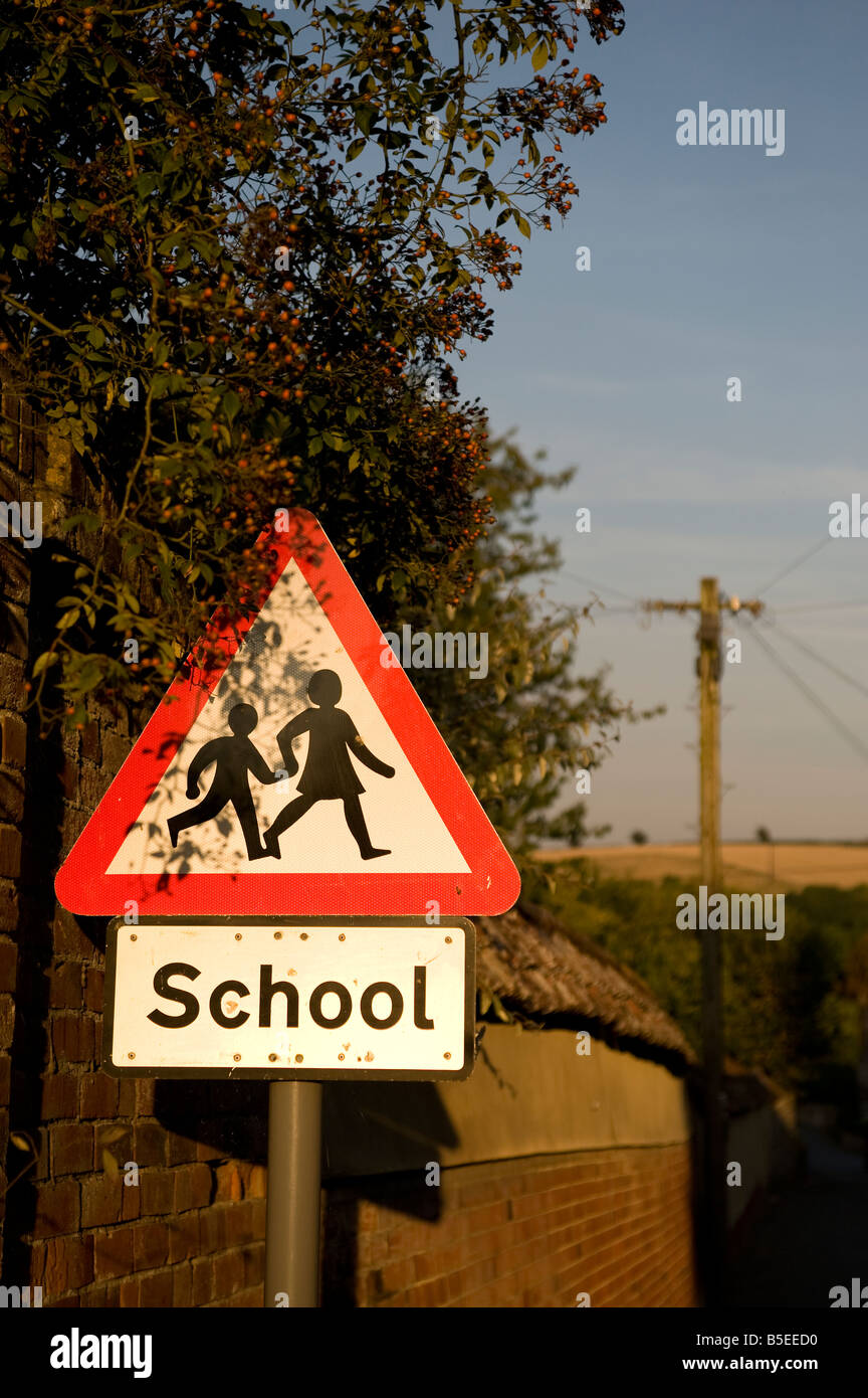 Triangular road sign for safe crossing of school children - Stock Image