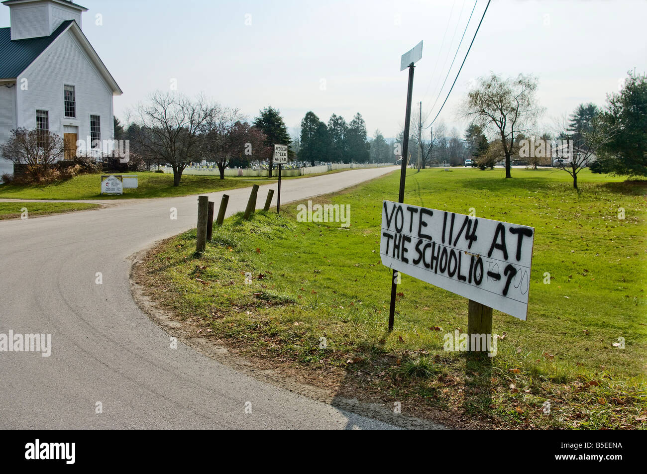 Spray painted voting sign posted on a corner in a small rural Vermont village Fletcher VT US 2008 Stock Photo