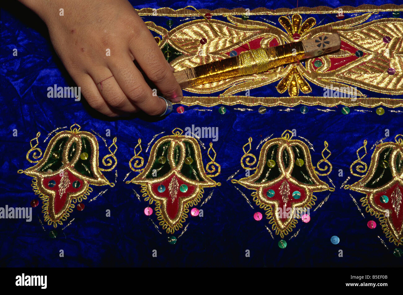 Detail of gold embroidery work in embroidery factory, Bukhara, Uzbekistan, Central Asia - Stock Image
