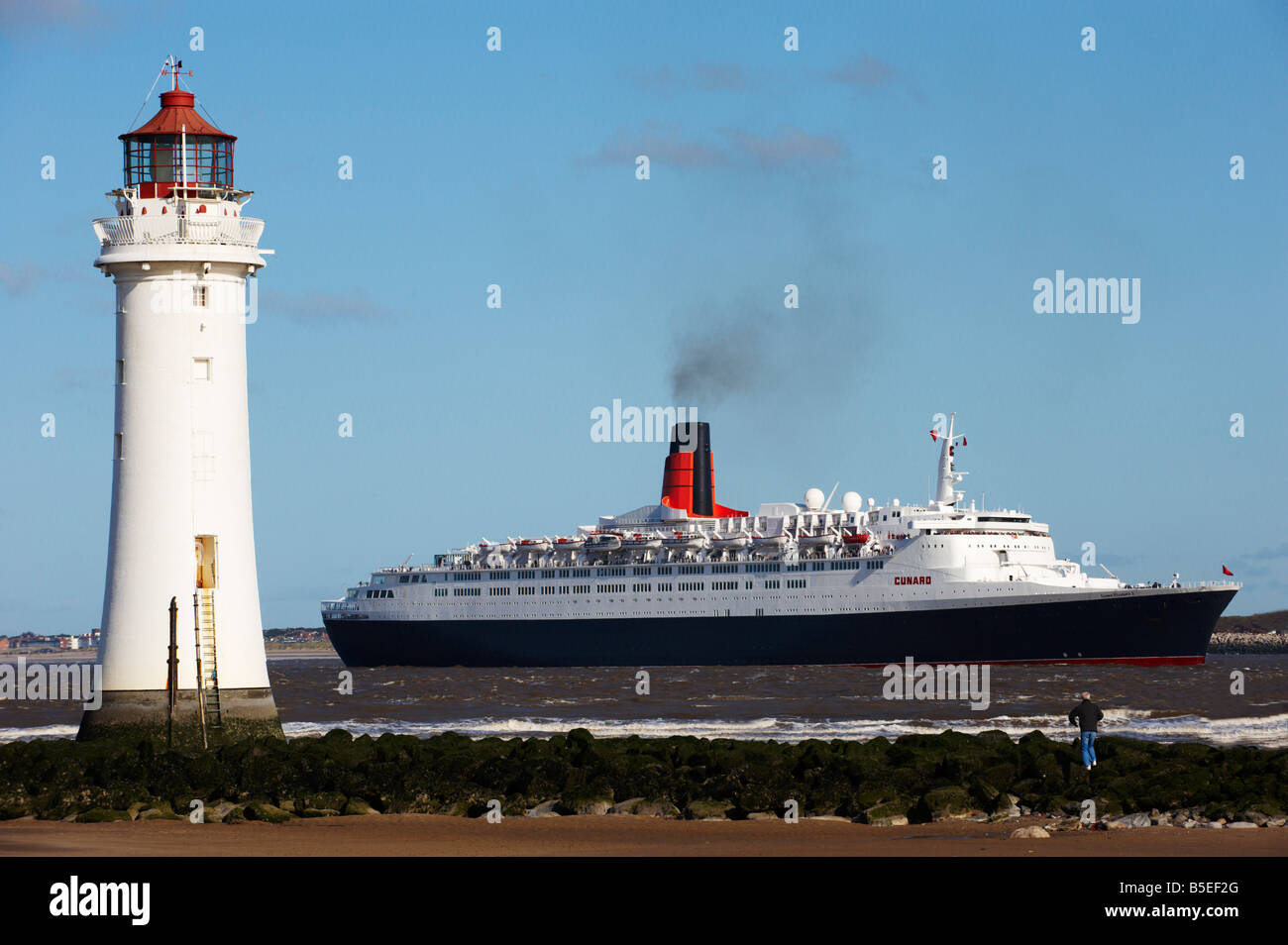 QE2 At Perch Rock Lighthouse New Brighton - Stock Image