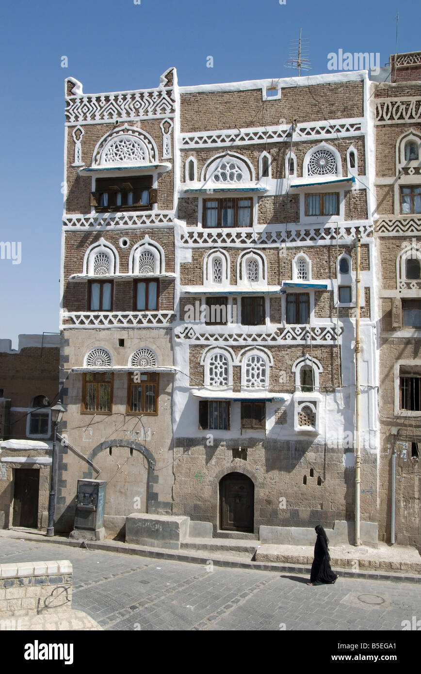 Traditional ornamented brick architecture on tall houses Old City Sana a capital of Yemen Middle East - Stock Image