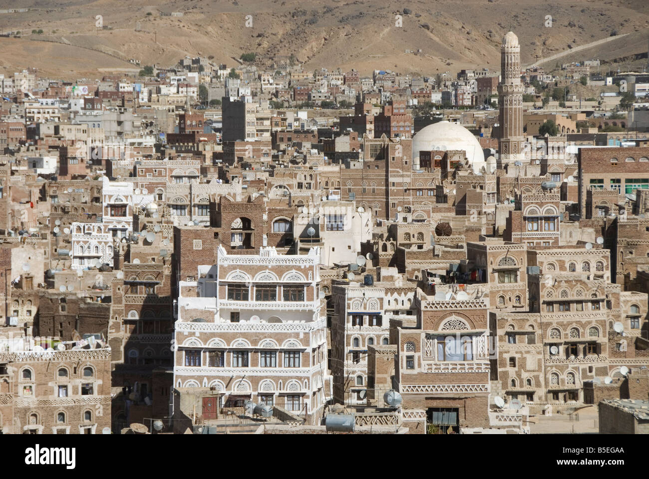 Traditional ornamented brick architecture on tall houses, Old City, within Sana'a, UNESCO World Heritage Site, - Stock Image
