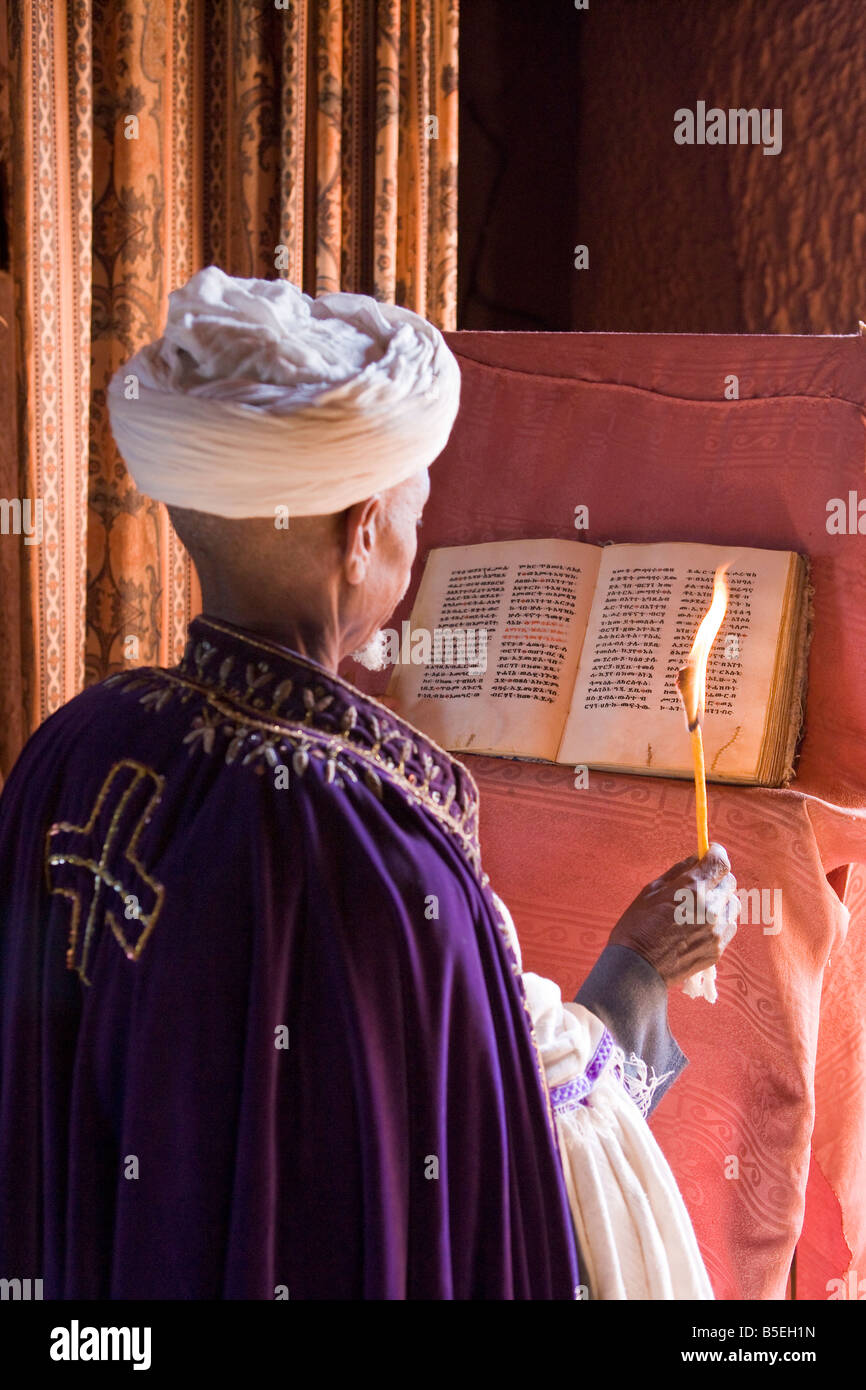 Africa, Ethiopia, Lalibela Priest reading the 900 year old Holy Book of Gabriel in Bet Gabriel Rufael - Stock Image