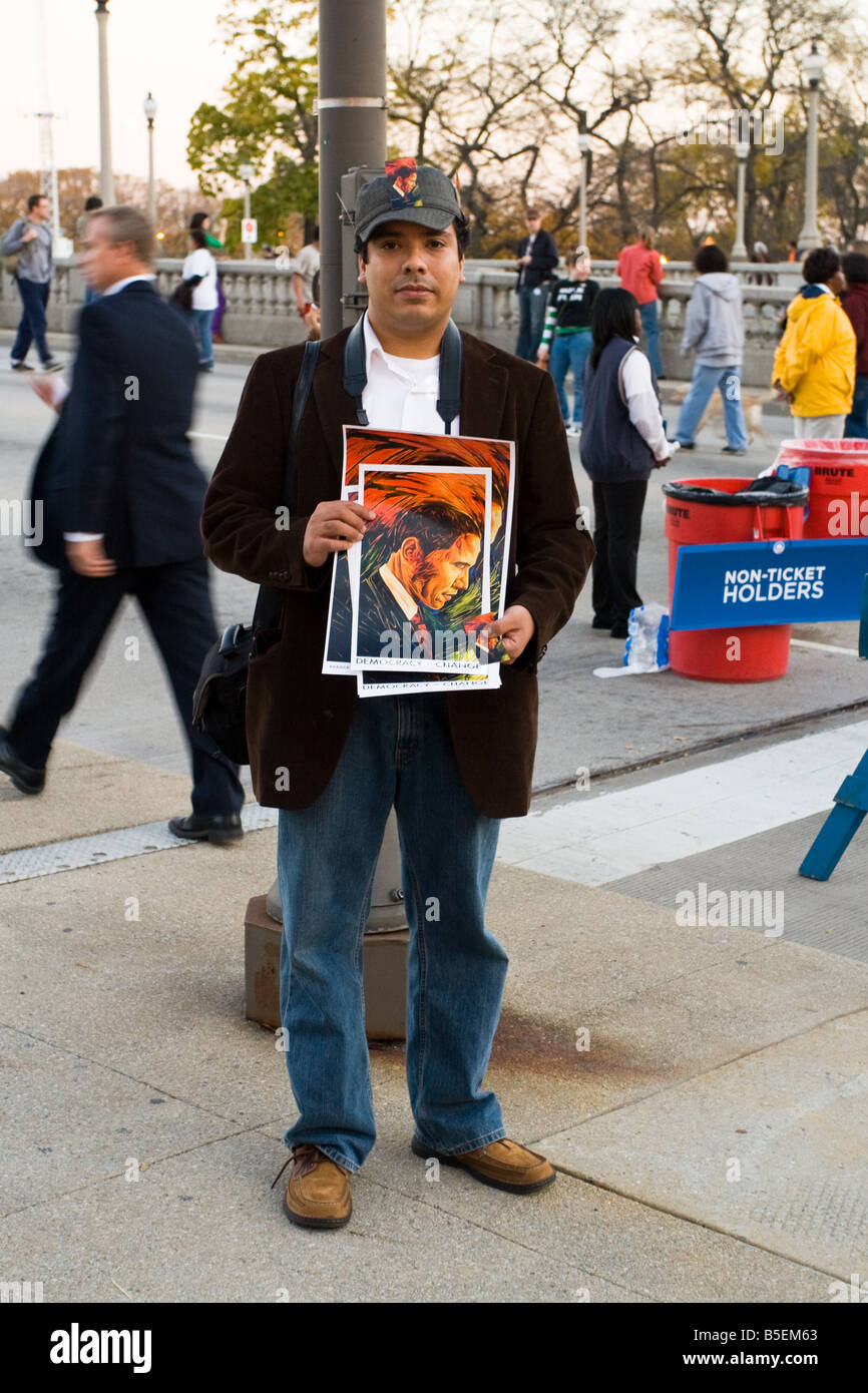 A man holding a portrait of Barack Obama before his presidential rally at Grant Park in Chicago Illinois on November - Stock Image